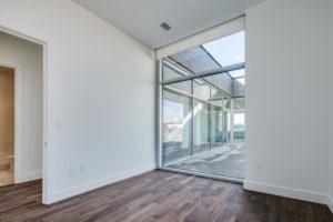 Floor to ceiling window looking onto terrace