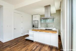 A white kitchen at hood vent, view 2, at 1555 Blake Street