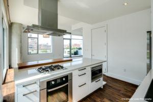 A white kitchen at hood vent at 1555 Blake Street