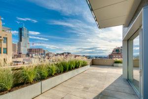 The exterior terrace looking into Denver cityscape